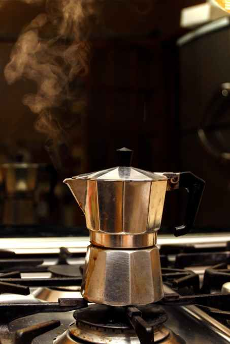 stainless steel coffee maker on stove