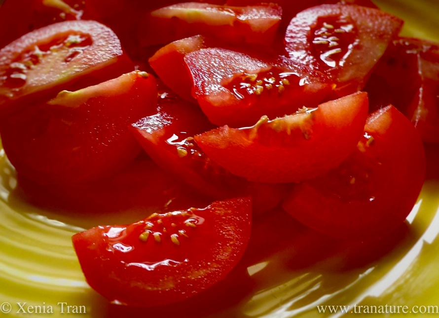 close up shot of chopped tomatoes on a yellow plate